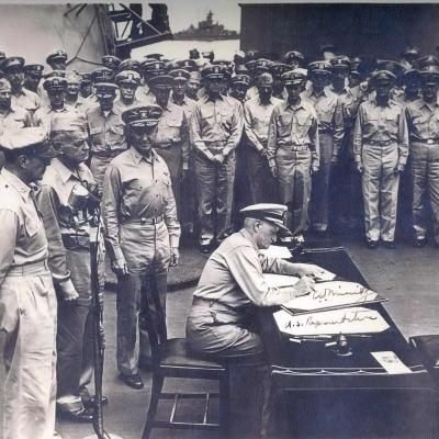 Admiral Nimitz signing terms of Japanese surrender