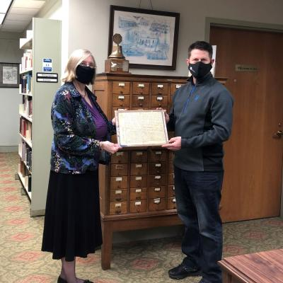 Becky Ebert and Mike Robinson with land grant document