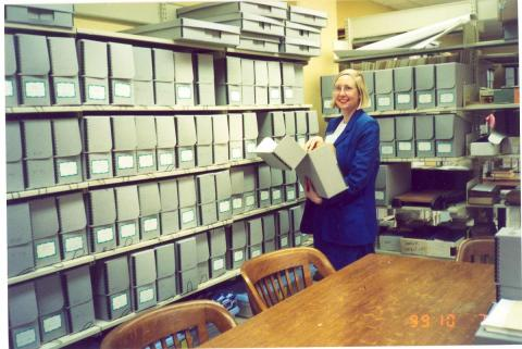 Rebecca Ebert, Archives Librarian, in the storage room of the Stewart Bell Jr. Archives